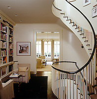 The dramatic curved staircase which runs up the seven floors of the house was inspired by a classical design