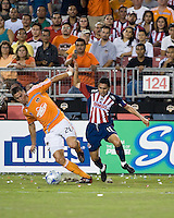 CD Guadalajara midfielder Ramon Morales (11) battles with Houston Dynamo midfielder Geoff Cameron (20) during the group stage of the Superliga 2008 tournament at Robertson Stadium in Houston, TX on July 15, 2008.