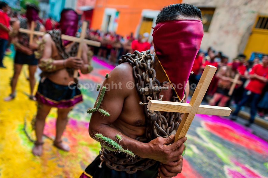 Chained Catholic devotees, wearing hoods and cactus spines stuck to their bodies, take part in the Holy week penitential procession in Atlixco, Mexico, 30 March 2018. Every year on Good Friday, dozens of anonymous men of all ages voluntarily undergo pain and suffering during the religious procession of the 'Engrillados' (the Shackled ones) in Puebla state, central Mexico. Wearing heavy chains on their shoulders covered with prickling cacti while being burned by the hot midday sun, they recall Jesus Christ's death by crucifixion and demonstrate their religiosity and faith.