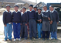 Children from the local Viñak School, a small town in the Andes of Lima Peru, pose for the camera