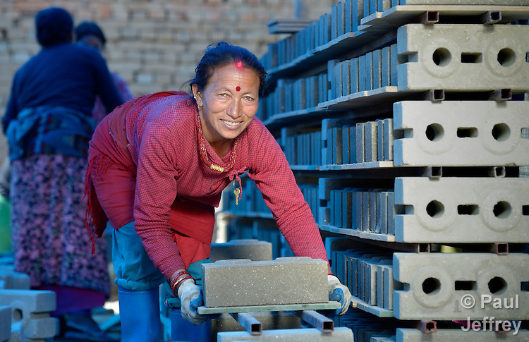 Kanchi Shrestha stacks blocks that she and other villagers in Sanogoan, Nepal, will use to build their new homes. This Newar community was hard hit by the April 2015 earthquake that ravaged Nepal, losing almost all their housing, but they've been helped by the ACT Alliance to rebuild their lives. The ACT Alliance has provided a variety of services here since the quake, including blankets, tents, and livelihood assistance, and is helping villagers form the tens of thousands of cement blocks they will need to construct permanent housing.