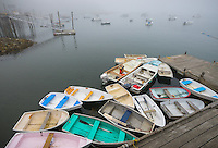 Central Coast, Maine:<br /> Morning fog on Friendship Harbor with dinghies at the wharf