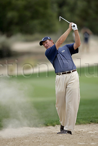 5 March 2005: South African golfer Ernie Els (RSA) looks into the distance after playing an iron from the desert just off the fairway during round fhree of the Dubai Desert Classic held on the Majlis Course at the Emirates Golf Club, Dubai, United Arab Emirates. Photo: Neil Tingle/Action Plus..050305 male man men golf golfer golfers