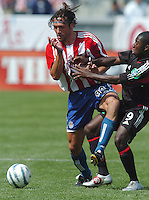 Chivas' Thiago Martins and D. C. United's Freddy Adu at the Home Depot Center, in Carson, California, Saturday, April 2, 2005.