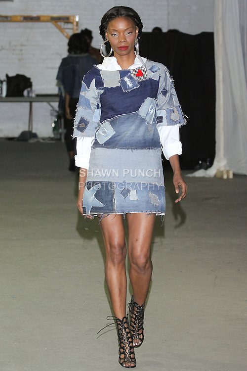 Model walks runway in a denim outfit by René Stewart-Pearce, during Fashion Week Brooklyn Fall Winter 2015.