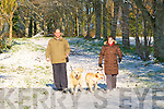 Exercise Time : Bill Fawaz Nuala Stewart exercising their dogs in the snow covered Listowel town Park on Sunday.