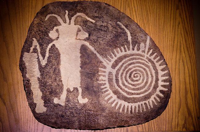 Freemont Ute petroglyph rock carving of spiritual leader (medicine man) and calendar symbols, Vernal, Utah