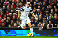 Sunday, 23 February 2014<br /> Pictured: Swansea City's Jonjo Shelvey runs with the ball<br /> Re: Barclay's Premier League, Liverpool FC v Swansea City FC v at Anfield Stadium, Liverpool Merseyside, UK.