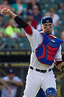 Round Rock Express catcher Robinson Chirinos (14) makes a throw to first base during the Pacific Coast League baseball game against the Salt Lake Bees on August 10, 2013 at the Dell Diamond in Round Rock, Texas. Round Rock defeated Salt Lake 9-6. (Andrew Woolley/Four Seam Images)