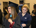 Kendra Tuttle, left, gets help with her gown before the University of Nevada, Reno morning Winter Commencement Ceremony at Lawlor Events Center in Reno, Saturday, Dec. 9, 2017.