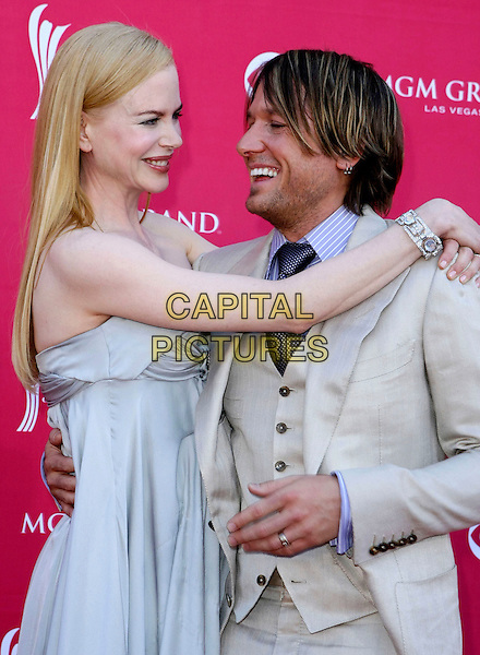 NICOLE KIDMAN & KEITH URBAN.The 43rd Annual Academy of Country Music Awards (ACM) held at MGM Grand Garden Arena, Las Vegas, Nevada, USA..May 18th, 2008.half length blue strapless dress diamond bracelet beige cream waistcoat arm over shoulder hug embrace stubble facial hair .CAP/ADM/MJT.© MJT/AdMedia/Capital Pictures.
