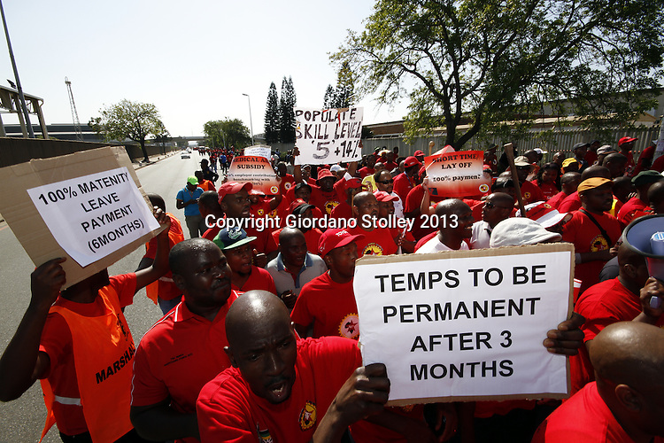 DURBAN - 23 August 2013 - Workers from the National Union of Metalworkers of South Africa protest outside the Toyota plant to demand a 14% salary increase. Some 31,000 Numsa workers cross the country at various motor manufactring plants downed tools after wage negotiations deadlocked. Automotive companies affected by the strike were BMW, Nissan, Mercedes, Volkswagen, General Motors, Toyota, UD Trucks, and MAN Truck and Bus. Picture: Allied Picture Press/APP