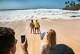HAWAII, Oahu, North Shore, Eddie Aikau, 2016, 66 year old Clyde Aikau, brother of Eddie Aikau preparing to head out during the Eddie Aikau 2016 big wave surf competition, Waimea Bay