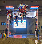 Racers compete in the AX Lites West Class during the Arena Cross motorcycle event held in the Reno Livestock Events Center on Saturday April 28, 2018.
