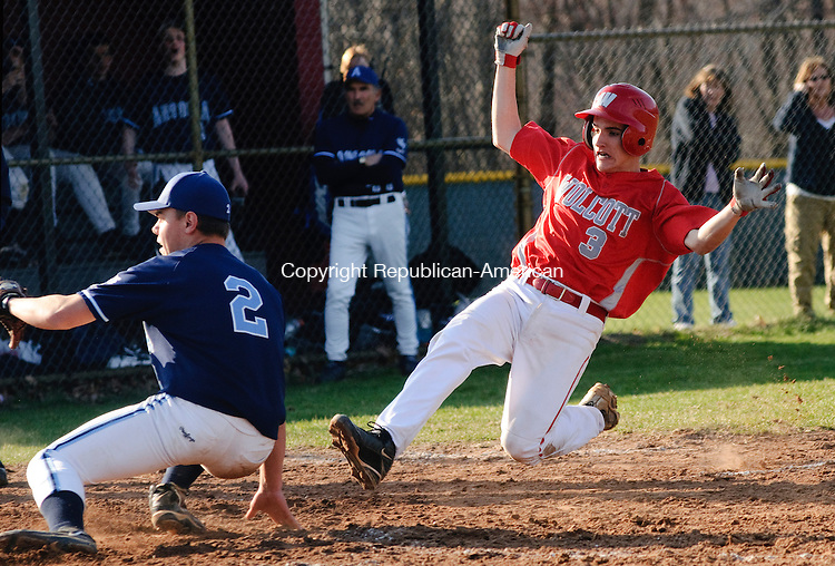 WATERBURY, CT, 14 APRIL 2011-041411JS02-- Wolcott's Brandon Lanzara (3) slides safely into home in front of the tag by Ansonia's Alex Westine (2) to score on a wild pitch during their game Thursday at Wolcott High School. <br /> Jim Shannon/Republican-American