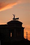 Silhouette view at sunset of King's Vittorio Emanuele I Memorial in Rome, Italy.