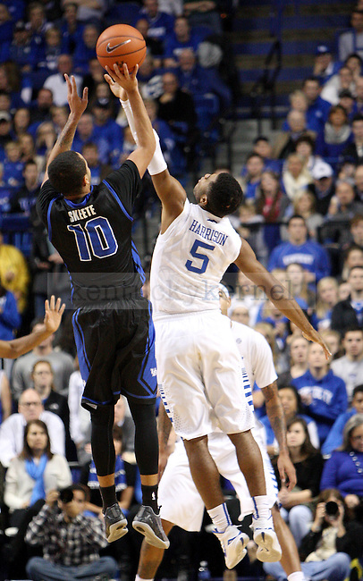 UK sophomore guard Andrew Harrison (5) jumps to block a shot by Buffalo junior guard Jarryn Skeete (10) during the first half of the University of Kentucky vs. State University of New York at Buffalo men's basketball game at Rupp Arena in Lexington, Ky., on Sunday, November 16, 2014. UK won 71-52. Photo by Tessa Lighty | Staff