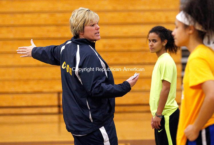 Waterbury, CT- 03 December 2015-120315CM19- Kennedy girls head basketball coach Jen Deeley runs through practice drills in Waterbury on Thursday.      Christopher Massa Republican-American