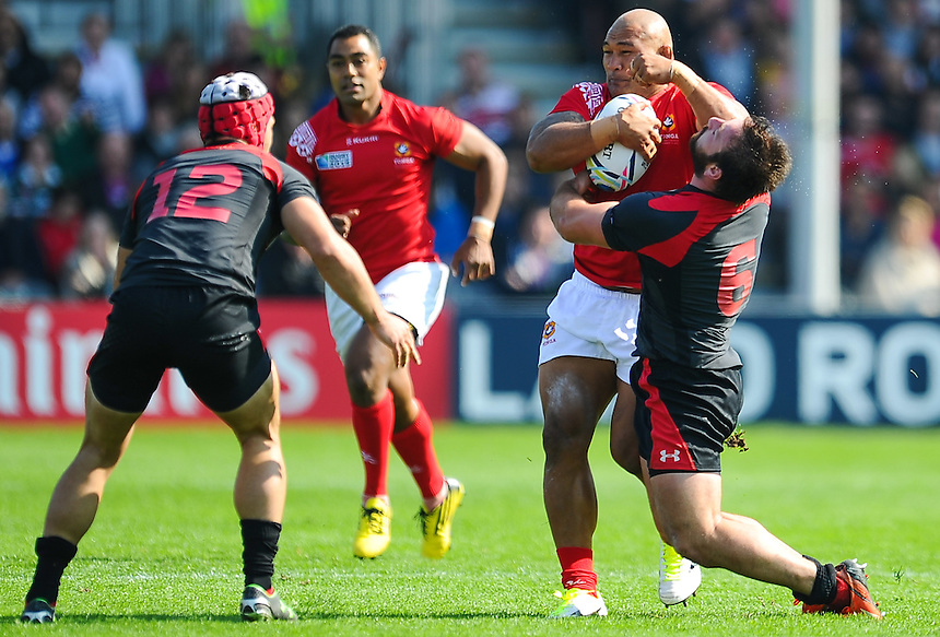 Tonga's Sona Taumalolo is tackled by Georgia's Vito Kolelishvili<br /> <br /> <br /> Photographer Craig Thomas/CameraSport<br /> <br /> Rugby Union - 2015 Rugby World Cup - 12;00  Georgia v Tonga - Saturday 19th September 2015 - Kingsholm - Gloucester <br /> <br /> &copy; CameraSport - 43 Linden Ave. Countesthorpe. Leicester. England. LE8 5PG - Tel: +44 (0) 116 277 4147 - admin@camerasport.com - www.camerasport.com