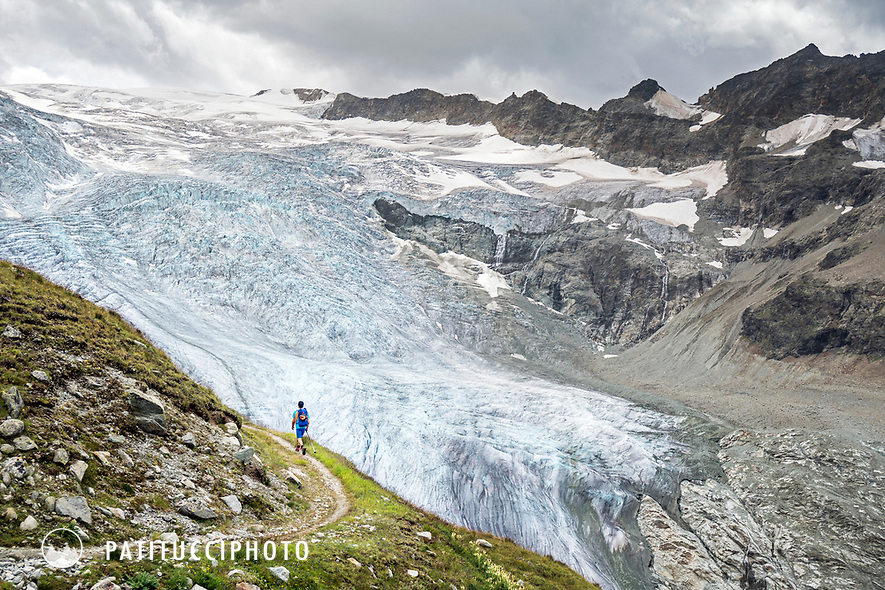Hiking next to the Glacier de Ferpècle while on the way to the Cabane de la Dent Blanche before climbing the peak. Switzerland.