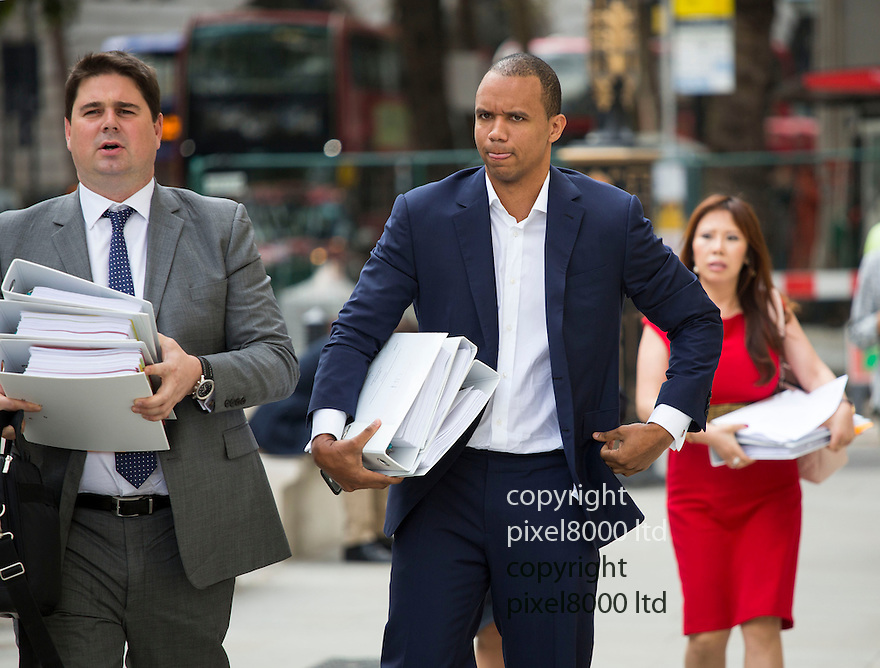 pic shows: world's number one poker star Phil Ivey arrives at the High Court in London today 2.10.14<br /> He arrived with his legal team carrying bundles of papers in his case against Crockfords casino in Mayfair, London which is owned by Gentings.<br /> <br /> The high stakes gambler who is suing Britain&rsquo;s oldest gaming club for withholding his &pound;7.3million payout<br /> They claim he was &quot;edge counting&quot;<br /> <br /> He arrived with two women of Asian appearance who may be part of his legal team or involved in the case.<br /> <br /> <br /> <br /> <br /> <br /> <br /> Pic by Gavin Rodgers/Pixel 8000 Ltd