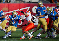 SAN FRANCISCO, CA - December 31, 2011: UCLA running back Derrick Coleman (33) competes against University of Illinois at AT&T Park in San Francisco, California. Final score Illinois wins 20-14.