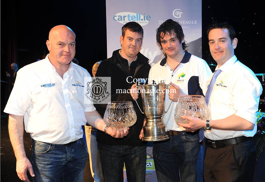 At the the cartell.ie  Gleneagle Hotel International rally of the lakes 2012 prizegiving ceremony in The INEC Killarney on Sunday  night were  from left, Dermot Healy, Clerk of  the course, John O'Donoghue presenting the Maurice O'Donoghue Memorial Cup to Gary Jennings and Jeff Aherne, cartell.ie.  Picture: Eamonn Keogh (MacMonagle, Killarney)