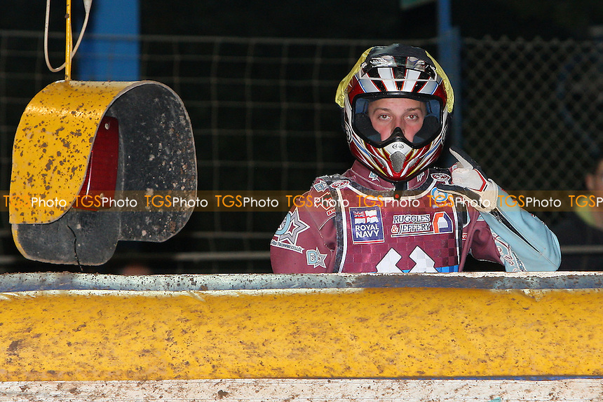 Rob Mear of Lakeside stays positive as he looks on over the air fence - Eastbourne Eagles vs Lakeside Hammers - Elite League Speedway Play-Off Semi-Final 2nd Leg at Arlington Stadium - 26/09/11 - MANDATORY CREDIT: Gavin Ellis/TGSPHOTO - Self billing applies where appropriate - 0845 094 6026 - contact@tgsphoto.co.uk - NO UNPAID USE.