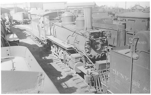 Engine #174 stored at Alamosa.<br /> D&amp;RGW  Alamosa, CO  Taken by Perry, Otto C. - 4/14/1935