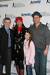 Tamara Tunie (gala co-chair) poses with Olympic Skater Timothy Goebel, Christopher Meloni and daughter Sophie at the 2009 Skating with the Stars - a benefit gala for Figure Skating in Harlem on April 6, 2009 at Wollman Rink, Central Park, NYC, NY. (Photo by  Sue Coflin/Max Photos)