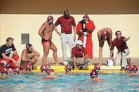 STANFORD, CA - October 9, 2010: Coaches talk to the team during a water polo game against USC in Stanford, California. Stanford beat USC 5-3.