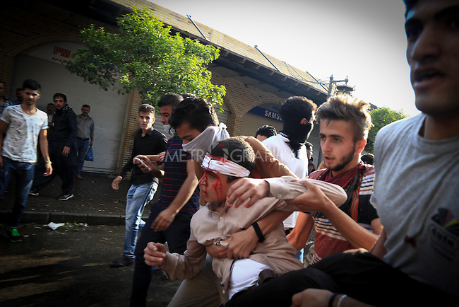 10/10/2015--Sulaimaniyah,Iraq-- A child is injured in head by throwing rocks and the conflict between the protestants and the police forces.