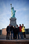 A Brazilian family poses for a picture at the Statue of Liberty  in New York, United States. 9/01/2012. Officials announced the arrival of the record-breaking 50 millionth visitor of the year. Photo by Kena Betancur / VIEWpress.