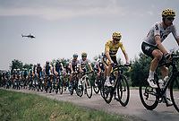 yellow jersey / GC leader Chris Froome (GBR/SKY) surrounded by teammates in the peloton<br /> <br /> 104th Tour de France 2017<br /> Stage 6 - Vesoul › Troyes (216km)