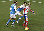 Atletico de Madrid's Fernando Torres (r) and UD Almeria's Verza (l) and Michel Macedo during La Liga match.February 21,2015. (ALTERPHOTOS/Acero)