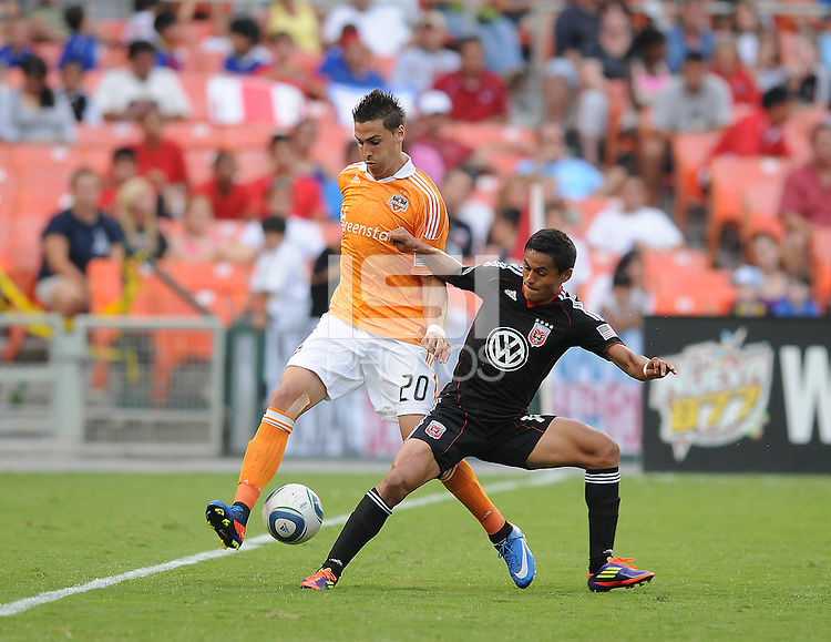 DC United midfielder Andy Najar (14) shields the ball against Houston Dynamo midfielder Geoff Cameron (20)   Houston Dynamo tied DC United 2-2, at RFK Stadium, Saturday June 25, 2011.