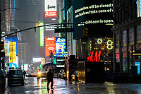 NEW YORK, NY - April 13:  A man around Times Square during a rainy day on April 13, 2020. in New York, United States. The global economy is facing the worst collapse since the WWII, while COVID-19  pandemic has now killed more than 22,000 people in the United States and at least 1,864,629 people died world wide. (Photo by Eduardo MunozAlvarez/VIEWpress)