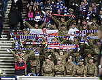 Members of Her Majesty's Armed Forces at Ibrox singing the National Anthem.