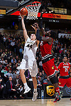 Dinos Mitoglou (44) of the Wake Forest Demon Deacons drives to the basket past Montrezl Harrell (24) of the Louisville Cardinals during first half action at the LJVM Coliseum on January 4, 2015 in Winston-Salem, North Carolina.  The Cardinals defeated the Demon Deacons 85-76.  (Brian Westerholt/Sports On Film)