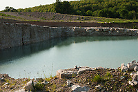 Water fills the dug-out area of a limestone quarry near Meaford, Ontario.