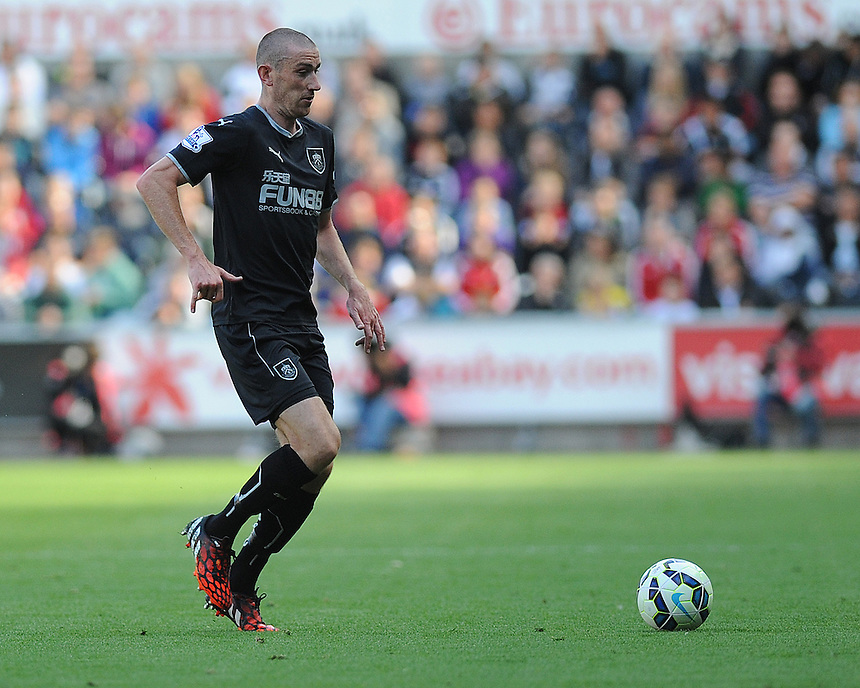 Burnley's David Jones in action during todays match  <br /> <br /> Photographer Ashley Crowden/CameraSport<br /> <br /> Football - Barclays Premiership - Swansea City v Burnley - Saturday 23rd August 2014 - Liberty Stadium - Swansea<br /> <br /> &copy; CameraSport - 43 Linden Ave. Countesthorpe. Leicester. England. LE8 5PG - Tel: +44 (0) 116 277 4147 - admin@camerasport.com - www.camerasport.com
