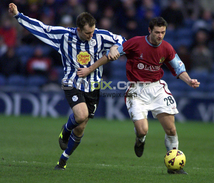 Pix, Shaun Flannery/SWpix. Nationwide League Division One..Burnley v Sheffield Wednesday,19/01/2002..COPYRIGHT PICTURE>>SIMON WILKINSON>>01943 - 436649>>..Wednesday's Matthew Hamshaw challenges Burnley's Alan Moore.