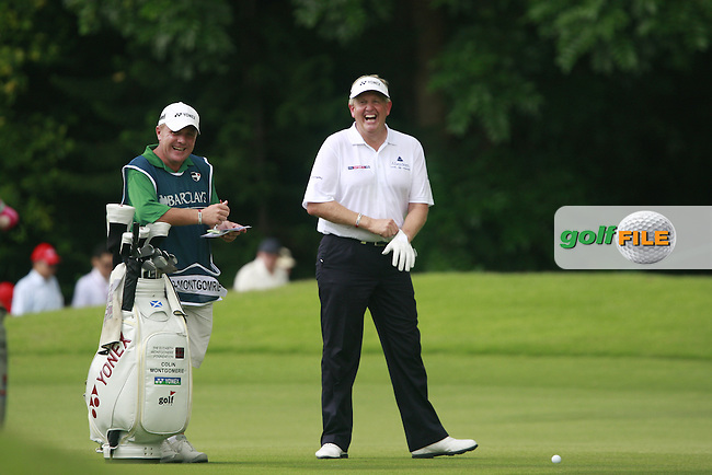 Colin Montgomerie (SCO) cant quite believe how much further Phil Mickelson has driven the ball on the 12th fairway during the rain delayed Round 3 of the 2011 Barclays Singapore Open, Singapore, 12th November 2011 (Photo Eoin Clarke/www.golffile.ie)