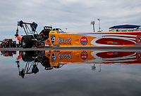 Aug 31, 2019; Clermont, IN, USA; The car of NHRA top alcohol dragster driver Brandon Greco reflects in puddle of rain water in the pits during qualifying for the US Nationals at Lucas Oil Raceway. Mandatory Credit: Mark J. Rebilas-USA TODAY Sports