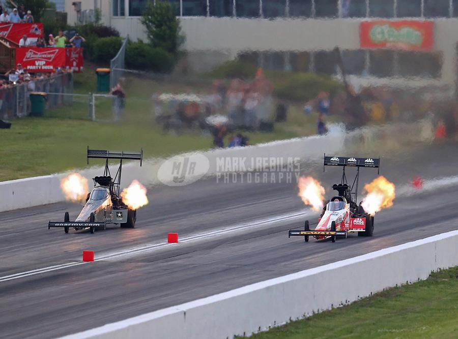 May 18, 2018; Topeka, KS, USA; NHRA top fuel driver Tony Schumacher (left) races alongside Doug Kalitta during qualifying for the Heartland Nationals at Heartland Motorsports Park. Mandatory Credit: Mark J. Rebilas-USA TODAY Sports