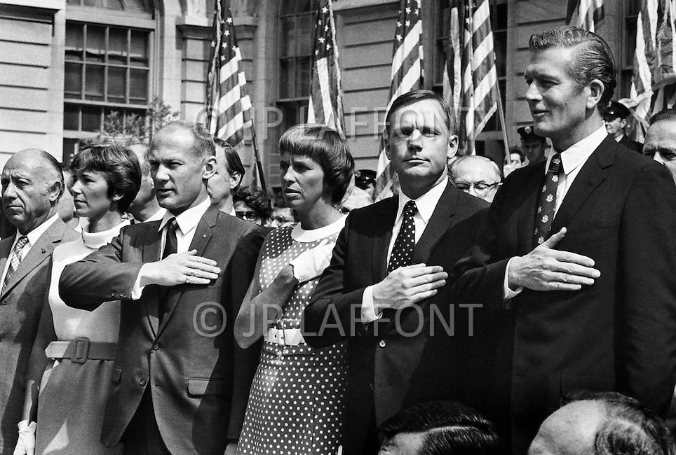 14 Aug 1969, Manhattan, New York City, New York State, USA --- L-R: Astronauts Michael Collins, Neil Armstrong and Buzz Aldrin with their medals alongside the Mayor of NYC, J. Lindsay and Thomas Paine, NASA administrator, after a parade that started from Grand Central Station.
