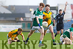 Cain Bradley of Listry in action against Brandon Hoare of Castlegregory in the Kerry County Junior Championship on Sunday in Austin Stack Park on Sunday.