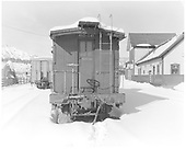 D&amp;RGW long caboose #0540 in Durango in snow with station in background.<br /> D&amp;RGW  Durango, CO  Taken by Payne, Andy M. - 12/27/1968