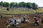 Riders head in to a turn on the course at the Unadilla Valley Sports Center in New Berlin, New York on July 16, 2006, during the AMA Toyota Motocross Championship.