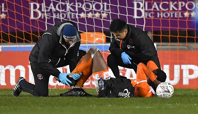 Blackpool's Joe Dodoo is treated on the pitch<br /> <br /> Photographer Dave Howarth/CameraSport<br /> <br /> The Emirates FA Cup Second Round Replay - Blackpool v Solihull Moors - Tuesday 18th December 2018 - Bloomfield Road - Blackpool<br />  <br /> World Copyright © 2018 CameraSport. All rights reserved. 43 Linden Ave. Countesthorpe. Leicester. England. LE8 5PG - Tel: +44 (0) 116 277 4147 - admin@camerasport.com - www.camerasport.com